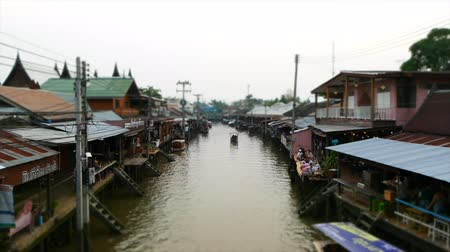 Samut Songkhram, Thailand - March 23 Amphawa floating market in Samut Songkhram, Thailand. It is one of the most popular floating markets in Thailand. Stock Footage