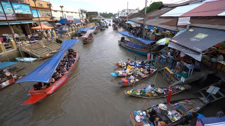 samut : Samut Songkhram, Thailand - April 20, 2018: Amphawa floating market in Samut Songkhram, Thailand. Tourists shopping and boat ride around in Amphawa floating market.