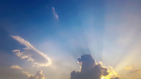 celestial : Time lapse clouds and sunset. Beautiful cloudscape with large, building clouds and sunrise breaking through cloud mass.