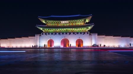 gyeongbok : Gyeongbokgung Palace at night and traffic in seoul city, south korea, 4K Timelapse.