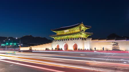 gyeongbok : Gyeongbokgung Palace, Cars passing in front of Gwanghuamun gate at Night in Downtown Seoul, South Korea. Name of the Palace Gyeongbokgung, 4K Timelapse. Stock Footage