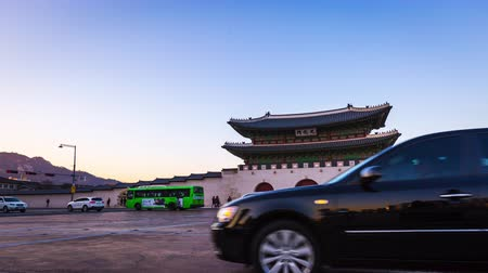 gyeongbok : Gyeongbokgung Palace, Cars passing in front of Gwanghuamun gate in downtown Seoul, South Korea. Name of the Palace Gyeongbokgung