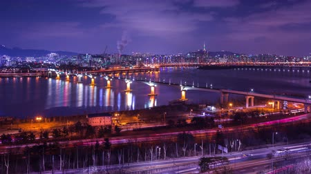 han river : Seoul city and Seoul tower at night with a bridge over the han river, South Korea, 4K, Time lapse.
