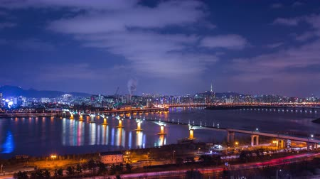 han river : Seoul city and Seoul tower at night with a bridge over the han river Traffic, South Korea, 4K, Time lapse.