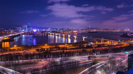 seoul : Seoul city and Seoul tower at night with a bridge over the han river Traffic, South Korea, 4K, Time lapse.