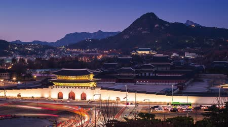 gyeongbokgung : Gyeongbokgung Palace and Cars passing in front of Gwanghuamun gate in downtown Seoul, South Korea. Name of the Palace Gyeongbokgung