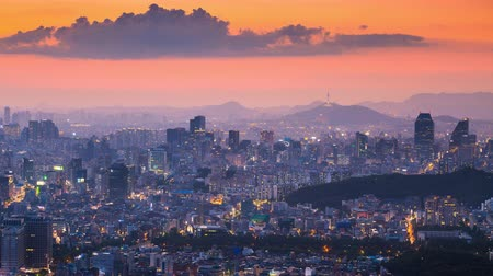 abeceda : Beautiful cityscape in sunset of Seoul, South Korea, Seoul tower modern building and architecture in Downtown Seoul. Timelapse.