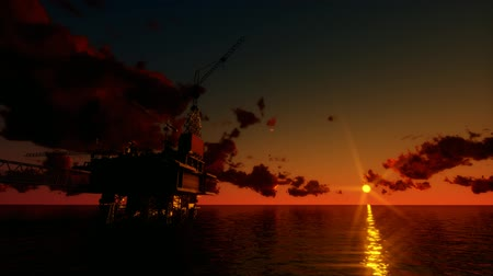 Oil platform in the sea at sunset