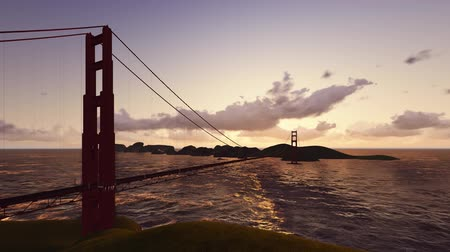 San Francisco Aerial v2 Flying low besides the Golden Gate Bridge at sunset. Stok Video