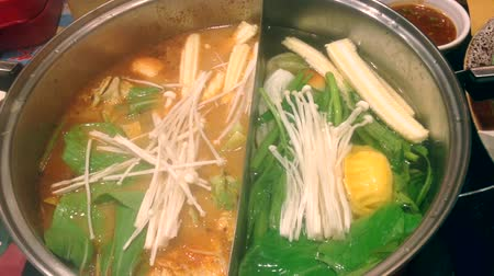 beef soup : Suki Tom Yum soup in a pot and vegetables.