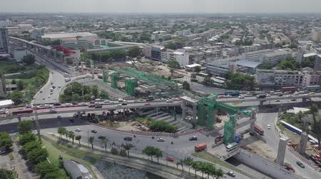岐路 : aerial view of public transport electricity train construction in the centre of roundabout and tunnel in Bangkok Thailand