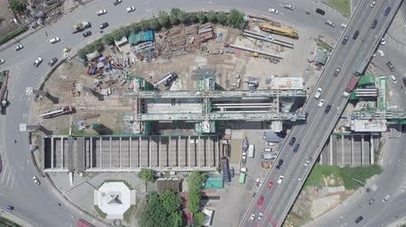 tünel : Aerial top view moving up of public transport electricity train construction in the centre of roundabout and tunnel in Bangkok Thailand
