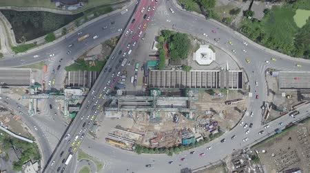 tünel : Aerial top view moving down of public transport electricity train construction in the centre of roundabout and tunnel in Bangkok Thailand