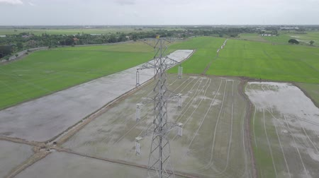 vezetékek : aerial view moving down of high voltage electricity pylon in farmland Thailand