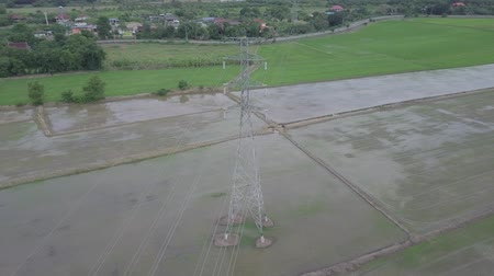 vezetékek : aerial view moving circle around high voltage electricity pylon in farmland Thailand Stock mozgókép
