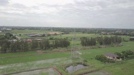 arame : aerial view moving over high voltage electricity pylon in farmland Thailand