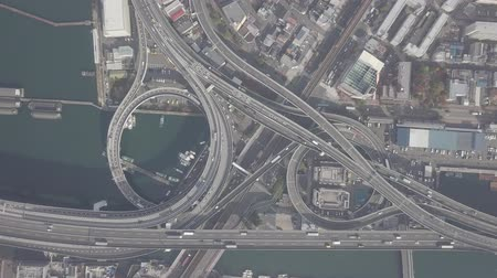 toll : Top view over the highway, expressway and highway, Aerial view interchange of Osaka City, Osaka, Kansai, Japan Stock Footage