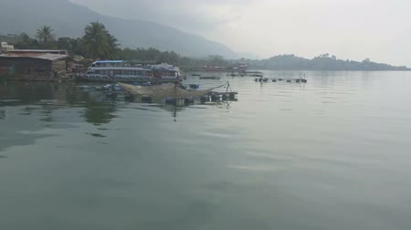 Toba lake with leaving the rural harbour scene.From Samosir island north Sumatra, Indonesia.Cannibal island