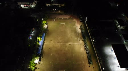 Aerial view of football stadium during the match at night