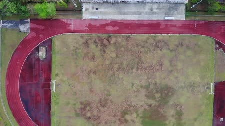 Aerial view above the abandoned stadium after rain
