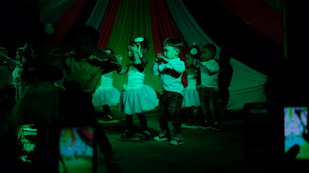 Trang, Thailand - December 27, 2018 : Children enjoy dancing together on stage celebrated for New years eve