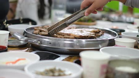 beef dishes : People enjoy grilled raw foods in the restaurant Stock Footage