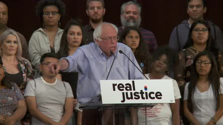 president of united states : Wall Street CROOKS. Bernie Sanders calls out the broken system during the 2008 financial crisis. June 2nd, 2018 at the Rally for Justice in downtown Los Angeles, California. Stock Footage