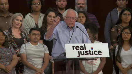 DIFFERENT SYSTEM OF JUSICE. Bernie Sanders compares how justice is served for certain crimes. June 2nd, 2018 at the Rally for Justice in downtown Los Angeles, California. Stock Footage