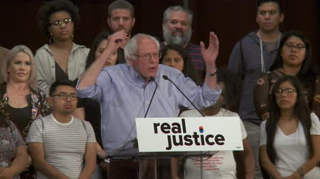activist : CANNOT AFFORD CASH BAIL. Bernie Sanders compares criminal offenses. June 2nd, 2018 at the Rally for Justice in downtown Los Angeles, California.