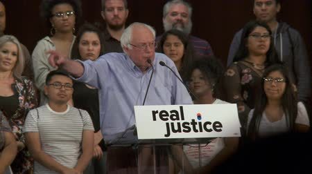president of united states : LIVES THEY DESERVE. Bernie Sanders urges to stand behind nations young people. June 2nd, 2018 at the Rally for Justice in downtown Los Angeles, California.