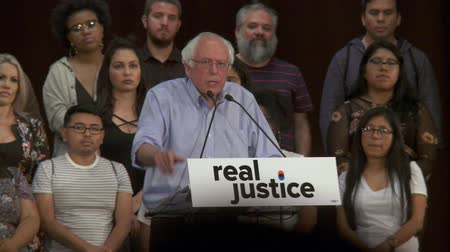 election campaign : BROKEN SYSTEM. Bernie Sanders blames poverty and racism for the problems. June 2nd, 2018 at the Rally for Justice in downtown Los Angeles, California. Stock Footage