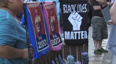 demokratický : BLACK LIVES MATTER T-Shirt. Merchandise for sale on June 2nd, 2018 at the Rally for Justice with Bernie Sanders in downtown Los Angeles, California.
