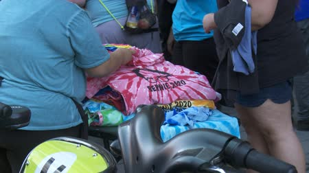 social inequality : BERNIE 2020 Tie-Dye Shirts. Bernie Sanders merchandise for sale on June 2nd, 2018 at the Rally for Justice in downtown Los Angeles, California.