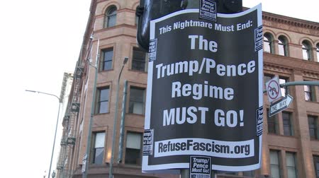 election campaign : TRUMPPENCE REGIME Sign. Protest sign calling for an end to the Donald Trump presidency on June 2nd, 2018 at the Rally for Justice in downtown Los Angeles, California. Stock Footage