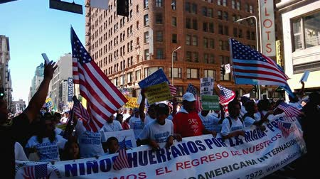 riot : Immigration Reform Rally. Hundreds of people, young and old, march while waving picket signs and American flags in the air, using noise makers, and cheer during an immigration rally in downtown Los Angeles on September 22, 2013.