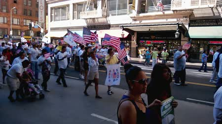 illegal alien : Rally Flags and Patriotism. Hundreds of people, young and old, march while waving American flags in the air during an immigration rally in downtown Los Angeles on September 22, 2013. Stock Footage