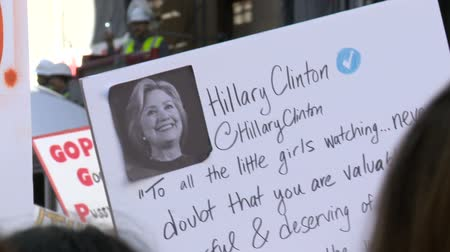 feminist : Sign with HILLARY CLINTON Quote. Protest sign at the Womens March in Los Angeles, California on January 21st, 2017, the day after Donald Trumps presidential inauguration. Stock Footage