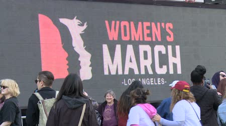 feminist : Womens March LA. Giant LCD billboard at the Womens March in Los Angeles, California on January 21st, 2017, the day after Donald Trumps presidential inauguration.