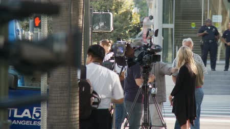 blm : Media News Cameras. Close on the lens of a news camera as reporters gather outside a City Hall rally in downtown Los Angeles, California on July 16th, 2013.