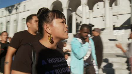 blm : JUSTICE Chant at City Hall. Protesters chant Justice For Trayvon Martin outside City Hall in downtown Los Angeles, California on July 16th, 2013.