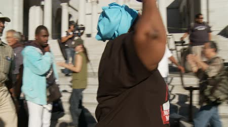 adli : NO JUSTICE Chant. Protesters chant Justice For Trayvon Martin outside City Hall in downtown Los Angeles, California on July 16th, 2013.