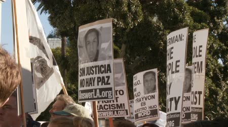 blm : Zoom In on Trayvon Martin. Snap zoom into a photo of slain teenager Trayvon Martin during a City Hall rally in downtown Los Angeles, California on July 16th, 2013. Stock Footage
