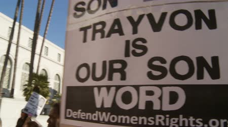 blm : TRAYVON IS OUR SON Sign. Banners with the photo of slain teenager Trayvon Martin at a City Hall rally in downtown Los Angeles, California on July 16th, 2013.