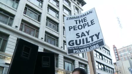 blm : THE PEOPLE SAY GUILTY Sign. Activist protests against George Zimmerman in downtown Los Angeles, California on July 16th, 2013.