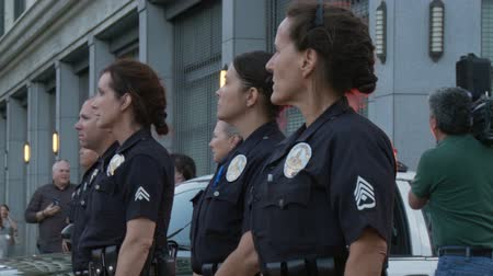 blm : Female Police Officers at Rally. Police officers watch and maintain a safety perimeter at a rally for Trayvon Martin in downtown Los Angeles, California on July 16th, 2013.