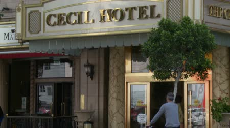 serial : Cecil Hotel Entrance. The camera tilts down from the Cecil Hotel sign above the entrance to the front doors to the lobby. Built in the 1920s, the Cecil Hotel in Downtown Los Angeles has become known for criminal activity including serveral murders, suic