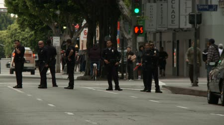 finest : LAPD Yellow Tape, Zoom Out. Officers wait at a blockade for protesters of the Occupy Movement in downtown Los Angeles, California on May 1st, 2012.