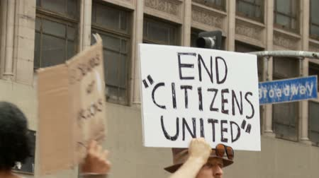 povstání : END CITIZENS UNITED Sign. Demonstrator protests against Citizens United at an Occupy Rally in downtown Los Angeles, California on May 1st, 2012.