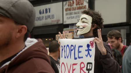 povstání : Anonymous For Peace. Protester wears a vendetta mask at an Occupy Rally in downtown Los Angeles, California on May 1st, 2012.