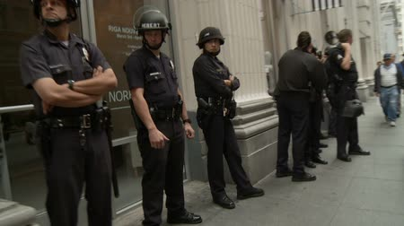 investigar : LA Cops Standing By. Cops wait and stand by in downtown Los Angeles, California on May 1st, 2012.